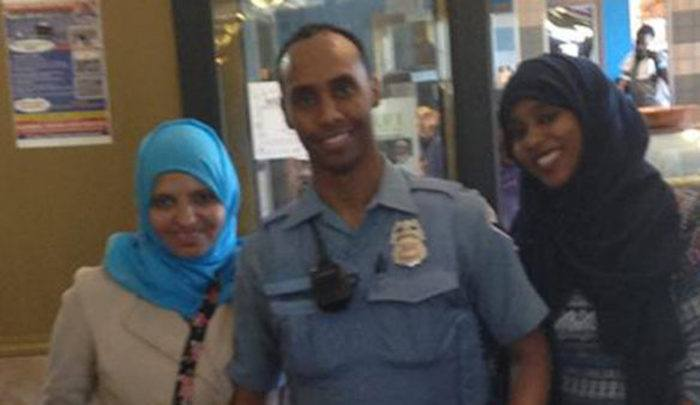 Minneapolis: Muslim cop who shot unarmed woman charged with murder, turns himself in