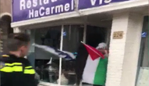 Netherlands video: Man holding Palestinian flag smashes windows of kosher restaurant in Amsterdam