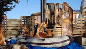 Italian mayor puts migrant dinghy in Nativity Scene