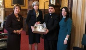 Iraqi Christian leader presents UK Prime Minister Theresa May with Bible burned by the Islamic State