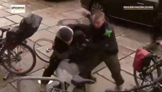 "Video from Germany: Muslim migrant screaming ""Allahu akbar"" rushes at Angela Merkel"
