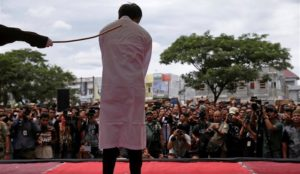 "Indonesia: Gay couple flogged over 80 times, woman caned for selling alcohol, crowd screams ""Hit them harder"""