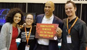 Pro- Palestinian group disputes Bookers claim that he didnt know sign he was holding was anti-Israel