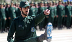 Iran's Islamic Revolutionary Guards Corps marches with Israeli flag on soles of boots