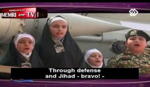 Islamic Republic of Iran: Children stand next to missiles and sing in praise of jihad and martyrdom