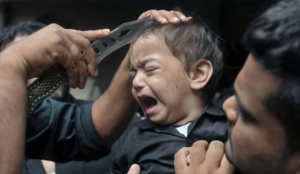 Shi'ite Muslims worldwide mark Ashura by slicing their heads open, and those of their children