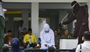Indonesia: Three couples publicly flogged for un-Islamic public affection