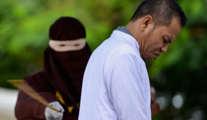 Indonesia: Muslim cleric publicly flogged for adultery under islamic law he helped draw up