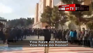 Iran: University students refuse to walk over US, Israeli flags, boo those who do