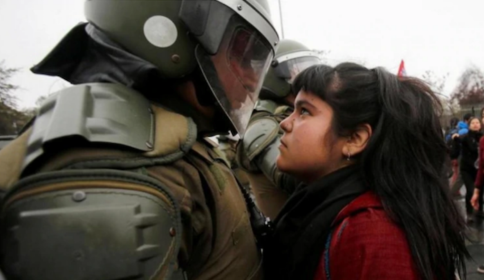 "Photo claimed to be of ""Palestinian"" girl staring down Israeli cop is actually from Chile in 2016"
