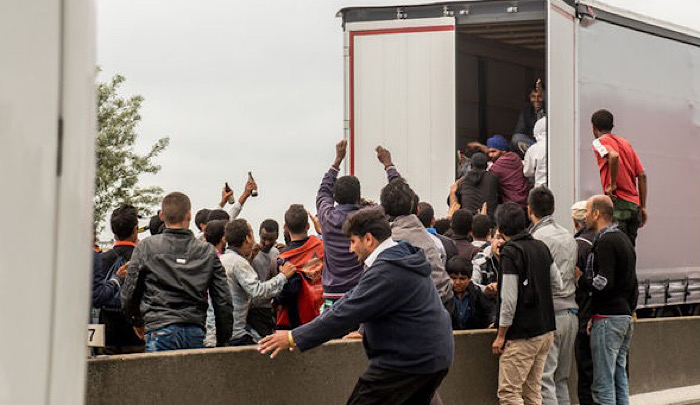 https://www.jihadwatch.org/wp-content/uploads/2021/04/Migrants-attacking-lorry.jpg