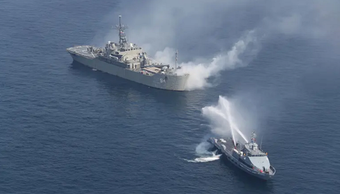 Two warships flying Iranian colors are sailing south and may be headed to Venezuela